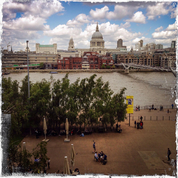 Looking across the Thames from the Tate Modern Museum; bridge is the Millennium walking bridge; large church dome is St. Paul's Cathedral (May, 2014)