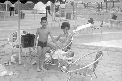 Emile, Mom and David cooling off at a hotel pool.  Tokyo 1965