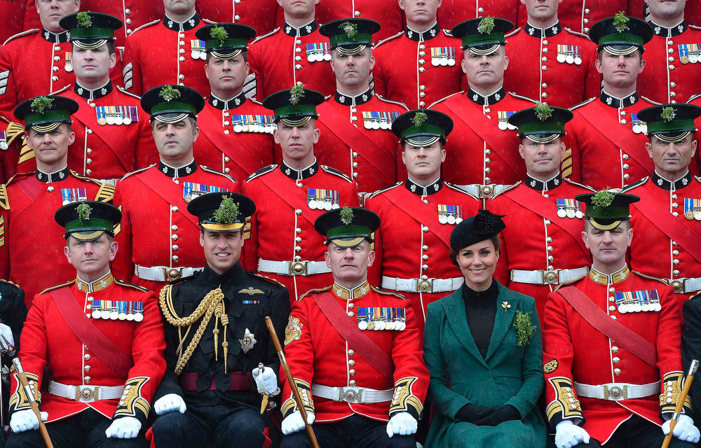 . Britain\'s Catherine, Duchess of Cambridge (2nd R) and her husband Prince William (2nd L) pose for an official photograph as they attend a St. Patrick\'s Day Parade at Mons Barracks in Aldershot, southern England on March 17, 2013. Prince William attended the parade as Colonel of the Regiment, and the Duchess presented the traditional sprigs of shamrocks to the Officers and Guardsmen of the Regiment.  REUTERS/Toby Melville