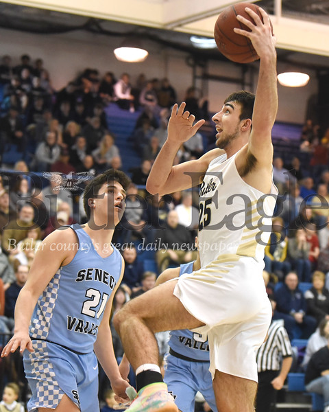 Butler's Ethan Morton goes up for a dunk past Seneca Valley's Mason Bush in Tuesday night's game at Butler. The Golden Tornado pulled away in the fourth quarter topping the Raiders 80-66. Seb Foltz/Butler Eagle