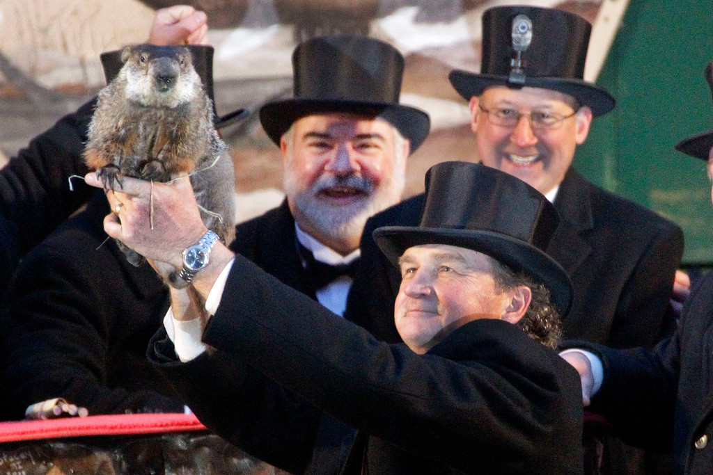 . Groundhog Club handler John Griffiths holds Punxsutawney Phil, the weather prognosticating groundhog, during the 126th celebration of Groundhog Day on Gobbler\'s Knob in Punxsutawney, Pa. Thursday, Feb. 2, 2012. Phil saw his shadow, forecasting six more weeks of winter weather. (AP Photo/Gene J. Puskar)