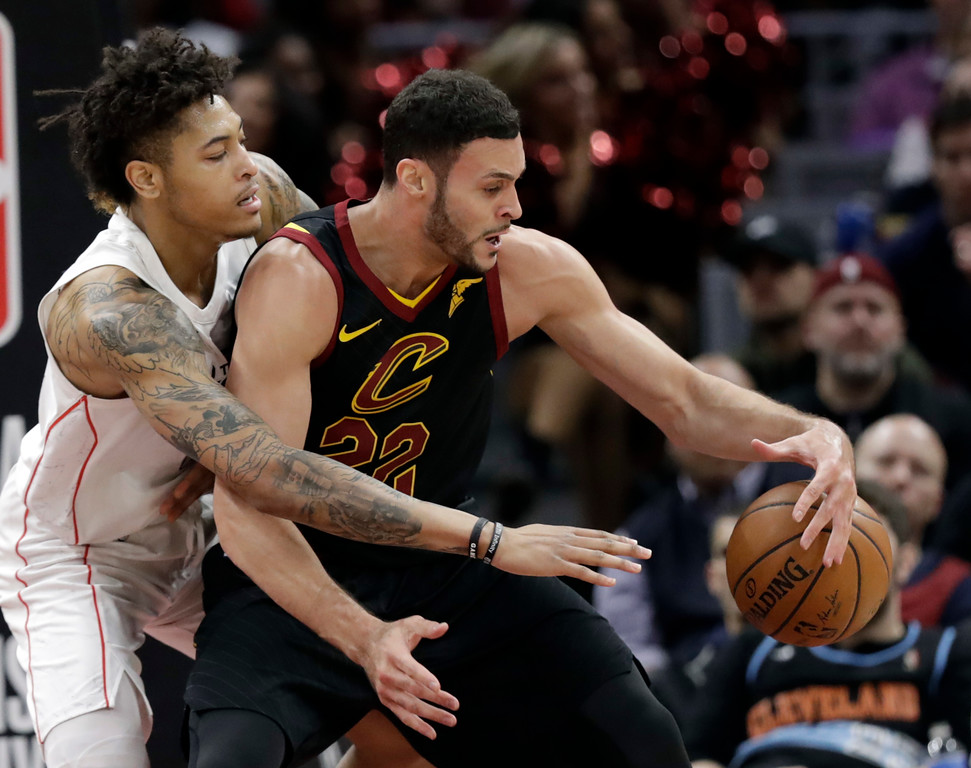 . Washington Wizards\' Kelly Oubre Jr., left, defends against Cleveland Cavaliers\' Larry Nance Jr. in the second half of an NBA basketball game, Thursday, April 5, 2018, in Cleveland. (AP Photo/Tony Dejak)
