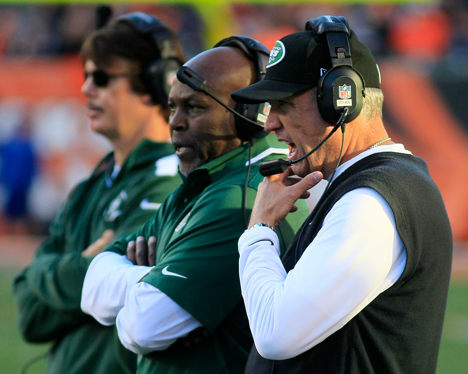 . New York Jets head coach Rex Ryan, right, watches on the sidelines during the first half of an NFL football game against the Cincinnati Bengals, Sunday, Oct. 27, 2013, in Cincinnati. (AP Photo/Tom Uhlman)