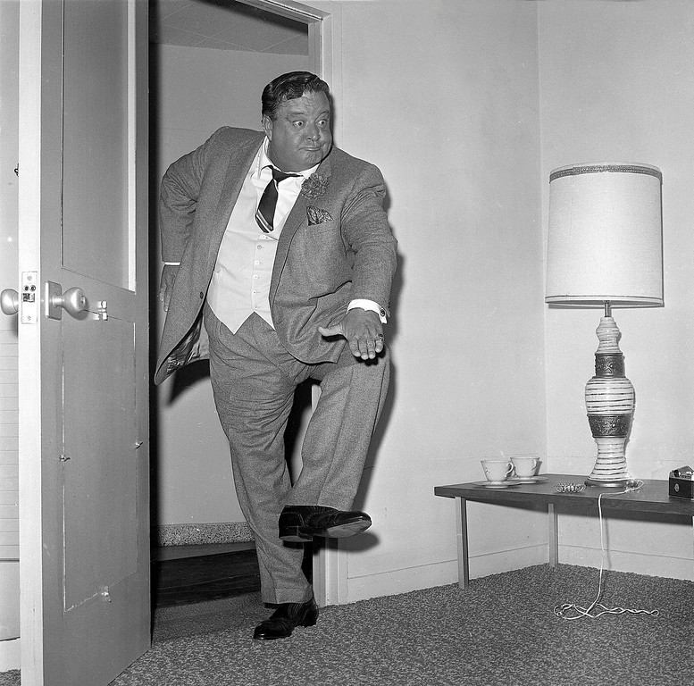. Comedian Jackie Gleason clowns for photographers after a news conference in Miami Beach, Fla., on Jan. 21, 1966.  (AP Photo)