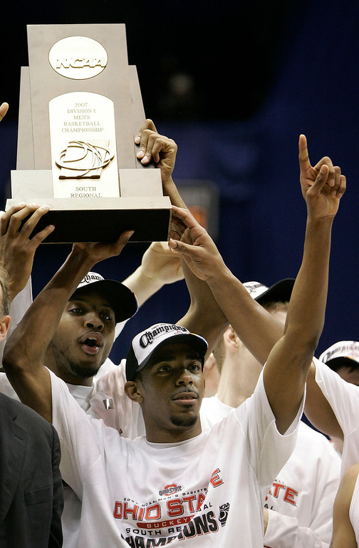 . Ohio State forward Ivan Harris, left, and Mike Conley Jr., front, react with their trophy following a 92-76 win over Memphis in the  NCAA South Regional final basketball game at the Alamodome in San Antonio Saturday, March 24, 2007.  (AP Photo/David J. Phillip)