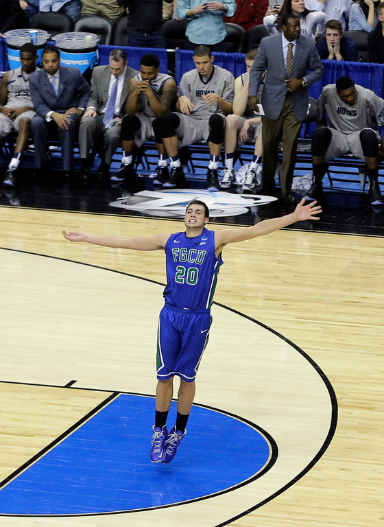 . Florida Gulf Coast\'s Chase Fieler celebrates in the final seconds of a second-round game against Georgetown in the NCAA college basketball tournament on Friday, March 22, 2013, in Philadelphia. Florida Gulf Coast won 78-68. (AP Photo/Matt Slocum)