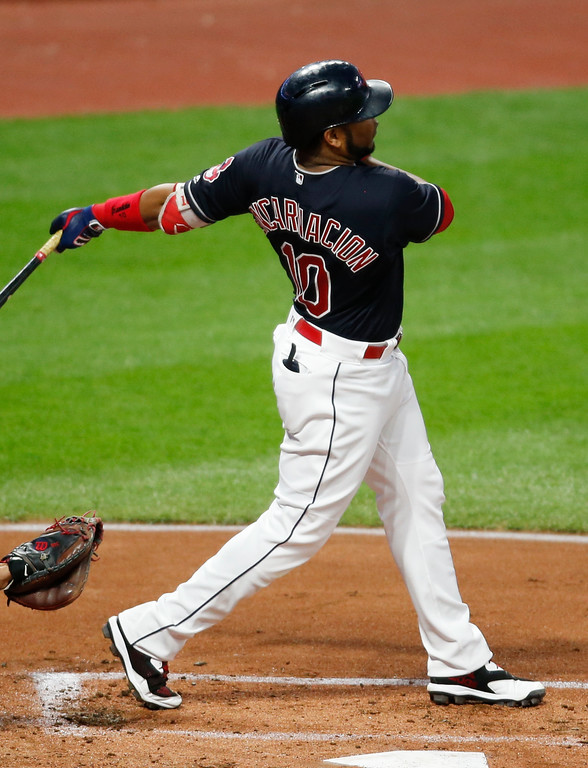 . Cleveland Indians\' Edwin Encarnacion hits a two RBI single off Minnesota Twins starting pitcher Bartolo Colon during the first inning in a baseball game, Tuesday, Sept. 26, 2017, in Cleveland. (AP Photo/Ron Schwane)