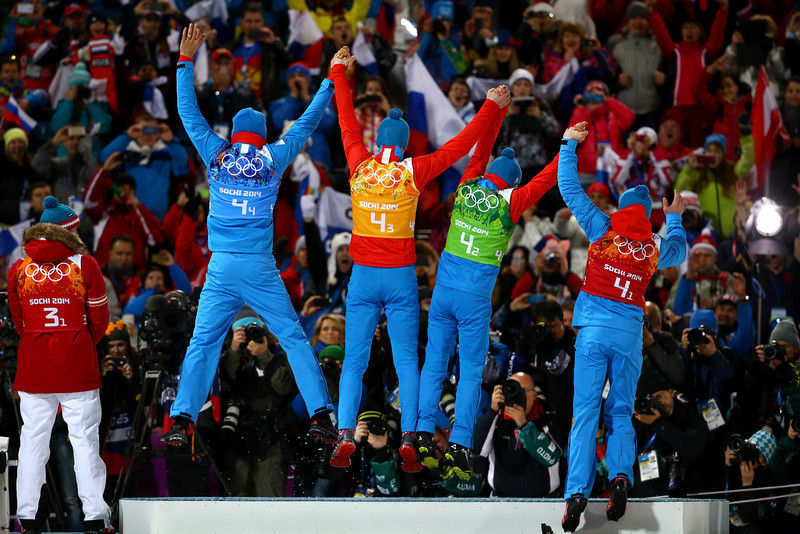 . Gold medalists (L-R) Anton Shipulin, Dmitry Malyshko, Evgeny Ustyugov and Alexey Volkov of Russia celebrate on the podium during the medal ceremony for the Men\'s 4 x 7.5 km Relay during day 15 of the Sochi 2014 Winter Olympics at Laura Cross-country Ski & Biathlon Center on February 22, 2014 in Sochi, Russia.  (Photo by Al Bello/Getty Images)