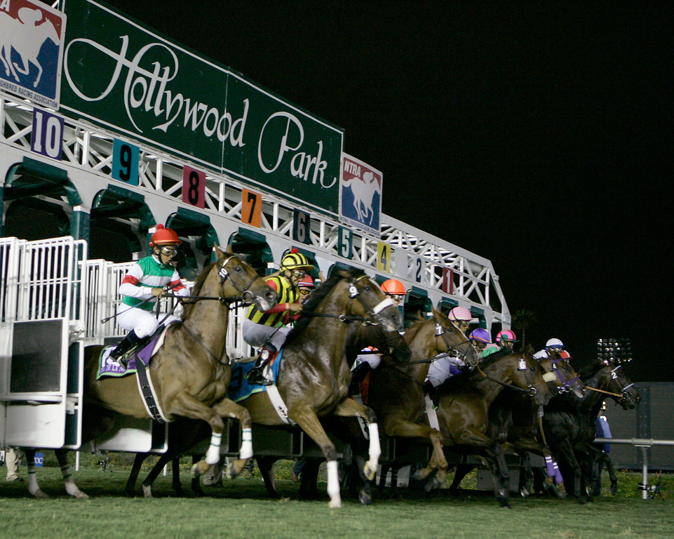 . Japanese horses Dia de la Novia, with jockey Yasunari Iwata, left, and Kiss of Heaven, with jockey Victor Espinoza, second from left, leave the starting gate in the CashCall Mile horse race at Hollywood Park in Inglewood, Calif., Friday, July 6, 2007. (AP Photo/Chris Carlson)