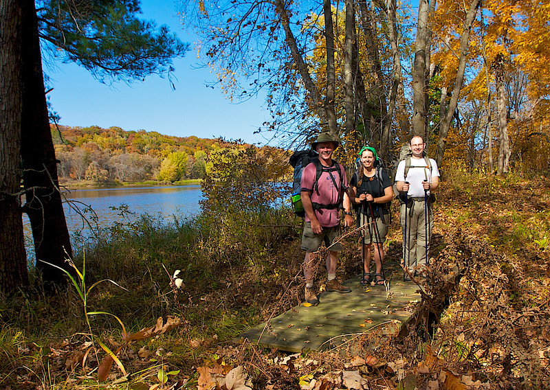 Jim, Jane and Brian backpacking on the east bank of the St. Croix River.