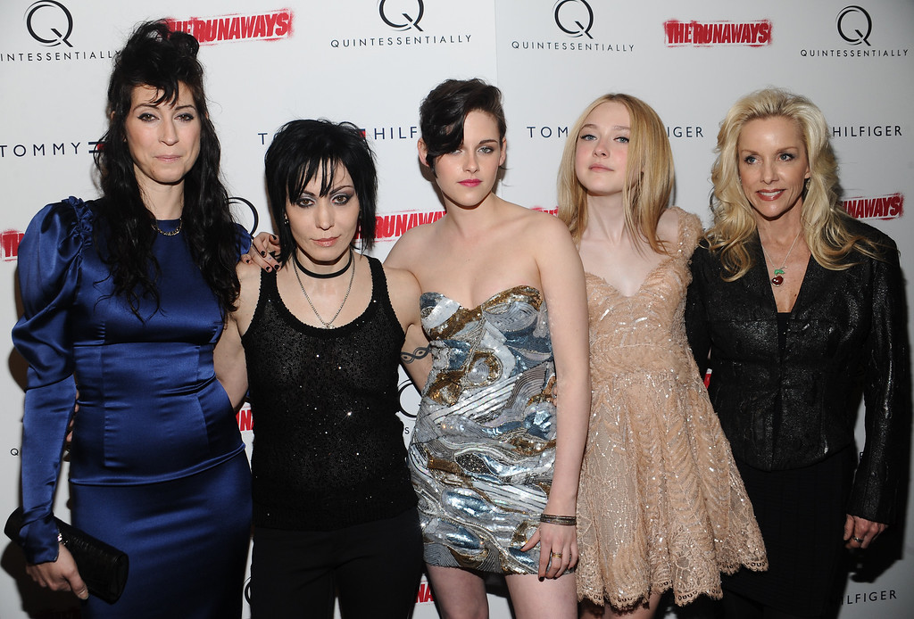 """. From left, writer - director Floria Sigismondi, musician Joan Jett, actress Kristen Stewart, Dakota Fanning and Cherie Currie attend a premiere for the film \""""The Runaways\"""" at the Landmark Sunshine Theater on Wednesday, March 17, 2010 in New York. (AP Photo/Evan Agostini)"""