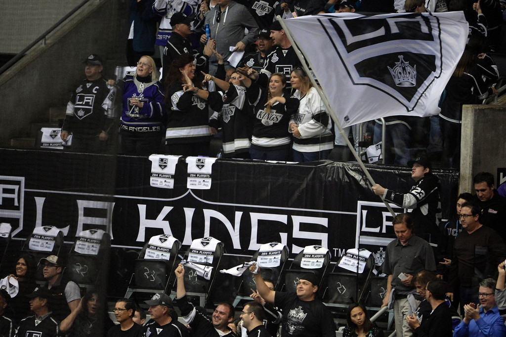 . Los Angeles Kings fans celebrate after a goal against the San Jose Sharks during the first period in Game 4 of an NHL hockey first-round playoff series at Staples Center in Los Angeles on Thursday, April, 24  2014.  (Keith Birmingham Pasadena Star-News)