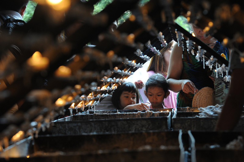. Roman Catholic devotee light candles at a church as the country marks Ash Wednesday, the official beginning of the Christian Lenten season in Manila on February 5, 2014. The ash symbolizes the mortality of human beings, of bodies disintegrating to ash after one dies. The Philippines is Asia\'s bastion of Catholicism, with over 80 percent of the about 100 million population belonging to the faith.  (JAY DIRECTO/AFP/Getty Images)