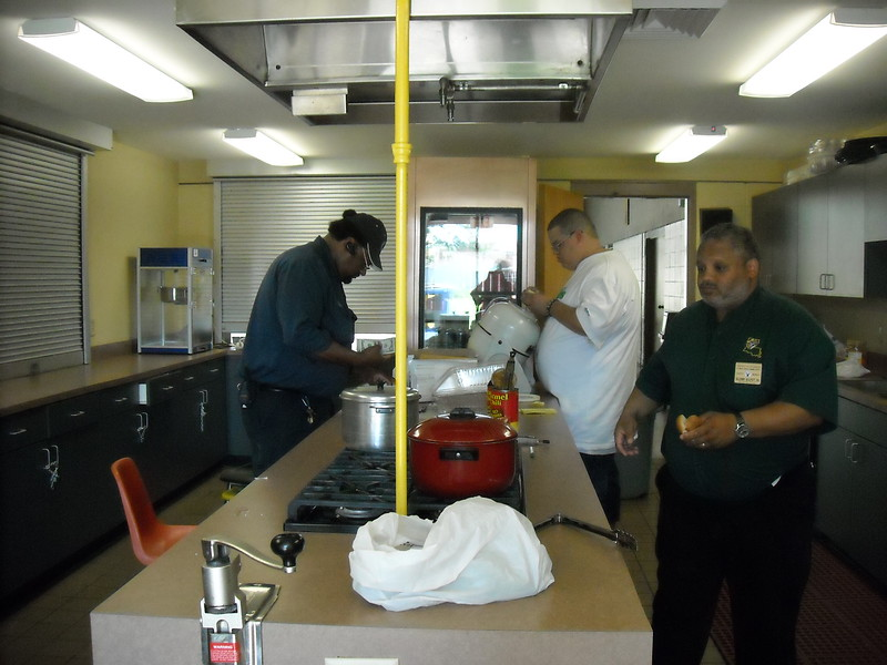 Glenn Gilyot and Keith Williams cooking Hot dogs in the Kitchen
