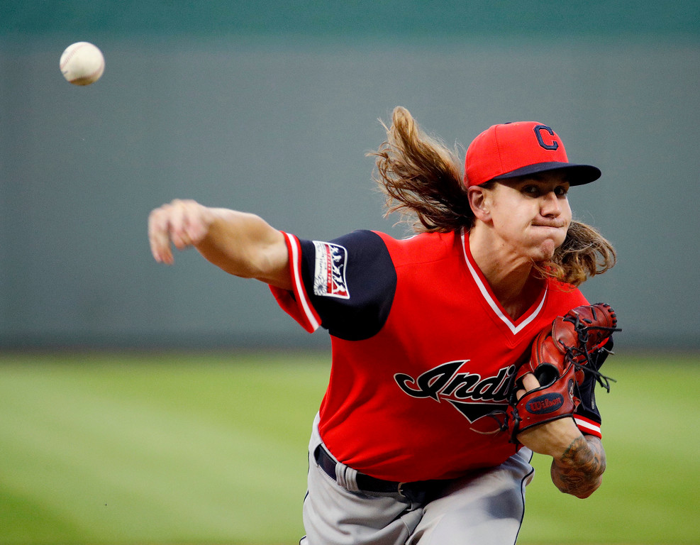 . Cleveland Indians starting pitcher Mike Clevinger throws during the first inning of the team\'s baseball game against the Kansas City Royals on Friday, Aug. 24, 2018, in Kansas City, Mo. (AP Photo/Charlie Riedel)