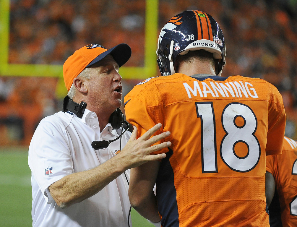 . Denver Broncos head coach John Fox congratulates Denver Broncos quarterback Peyton Manning (18) after a touchdown in the second quarter.   (Photo by Tim Rasmussen/The Denver Post)