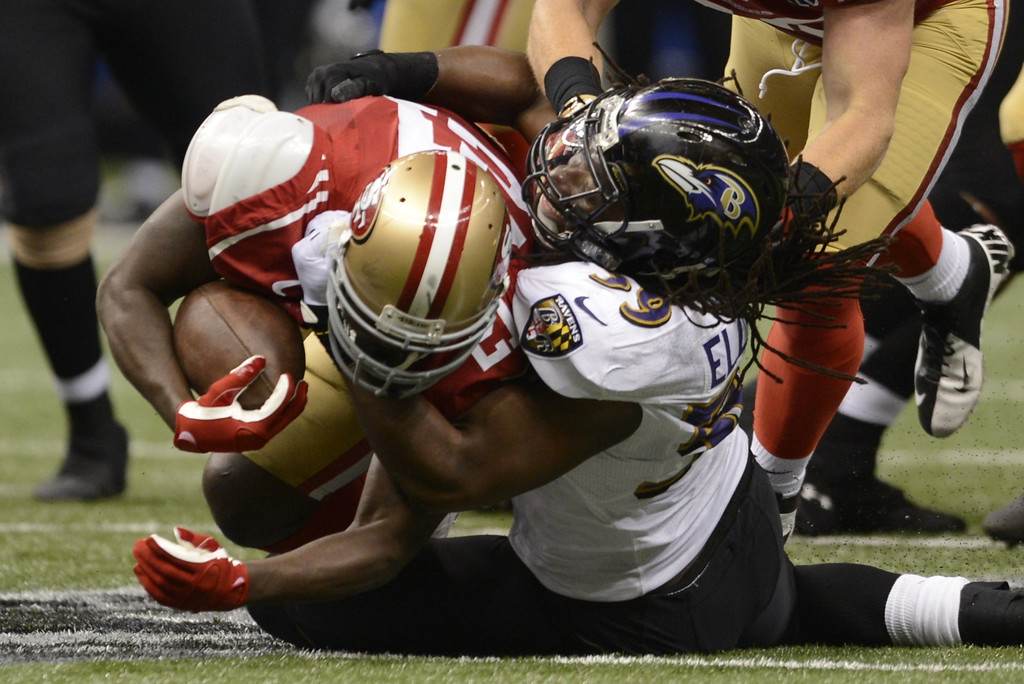. Dannell Ellerbe  (R) of the Baltimore Ravens brings down Frank Gore (L) of the San Francisco 49ers during Super Bowl XLVII at the Mercedes-Benz Superdome on February 3, 2013 in New Orleans, Louisiana.     TIMOTHY A. CLARY/AFP/Getty Images