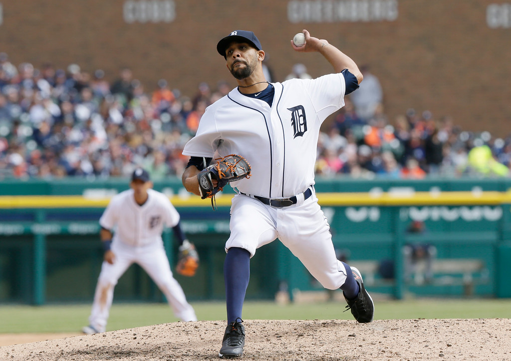 . Detroit Tigers starting pitcher David Price throws in the ninth inning of an opening day baseball game against the Minnesota Twins in Detroit, Monday, April 6, 2015. (AP Photo/Carlos Osorio)