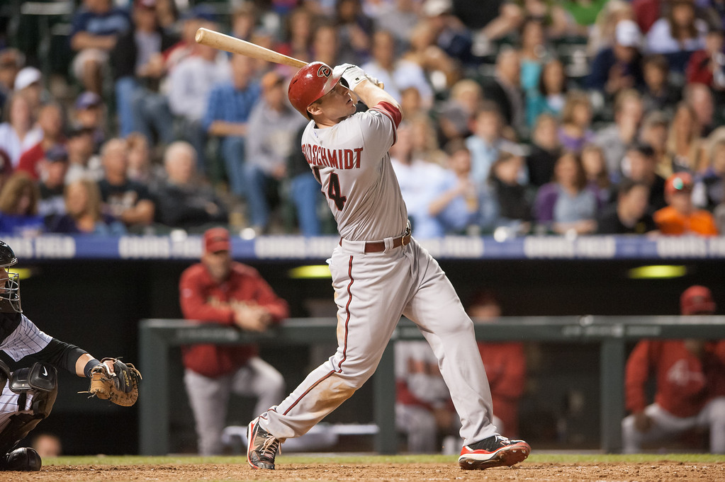 . DENVER, CO - SEPTEMBER 20:  Paul Goldschmidt #44 of the Arizona Diamondbacks watches the flight of a seventh-inning solo home run against the Colorado Rockies during a game at Coors Field on September 20, 2013 in Denver, Colorado. (Photo by Dustin Bradford/Getty Images)