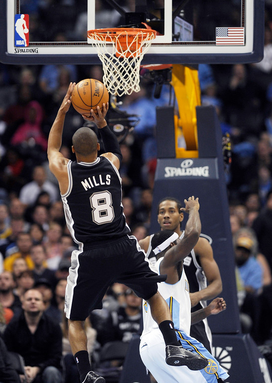 . Patty Mills #8 of the San Antonio Spurs puts up a jump shot during the fourth quarter of an NBA game against the Denver Nuggets at the Pepsi Center on November 5, 2013, in Denver, Colorado. The Nuggets fell to the Spurs 102-94 and are now 0-3. (Photo by Daniel Petty/The Denver Post)
