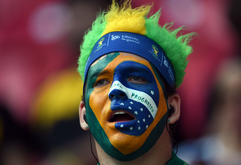 . A Brazilian fan waits for the start of the round of 16 football match between Costa Rica and Greece at Pernambuco Arena in Recife during the 2014 FIFA World Cup on June 29, 2014. AFP PHOTO / PEDRO UGARTE