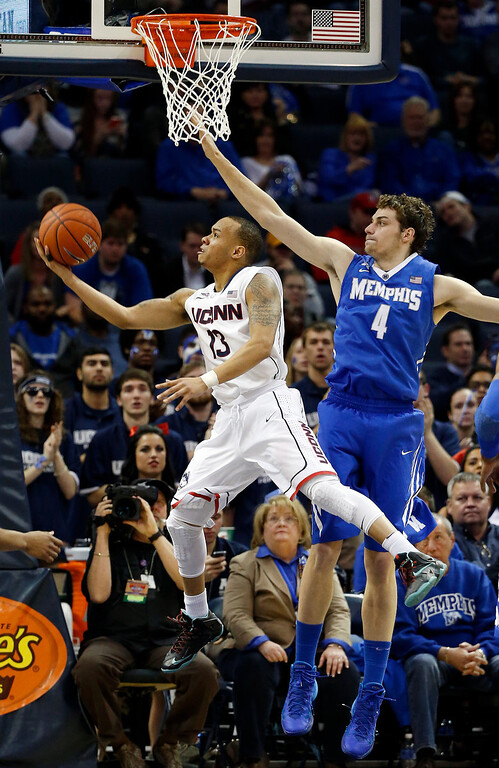 . Connecticut guard Shabazz Napier (13) drives past Memphis forward Austin Nichols (4) to score during the second half of an NCAA college basketball game in the quarterfinals of the American Athletic Conference men\'s tournament Thursday, March 13, 2014, in Memphis, Tenn. (AP Photo/Mark Humphrey)