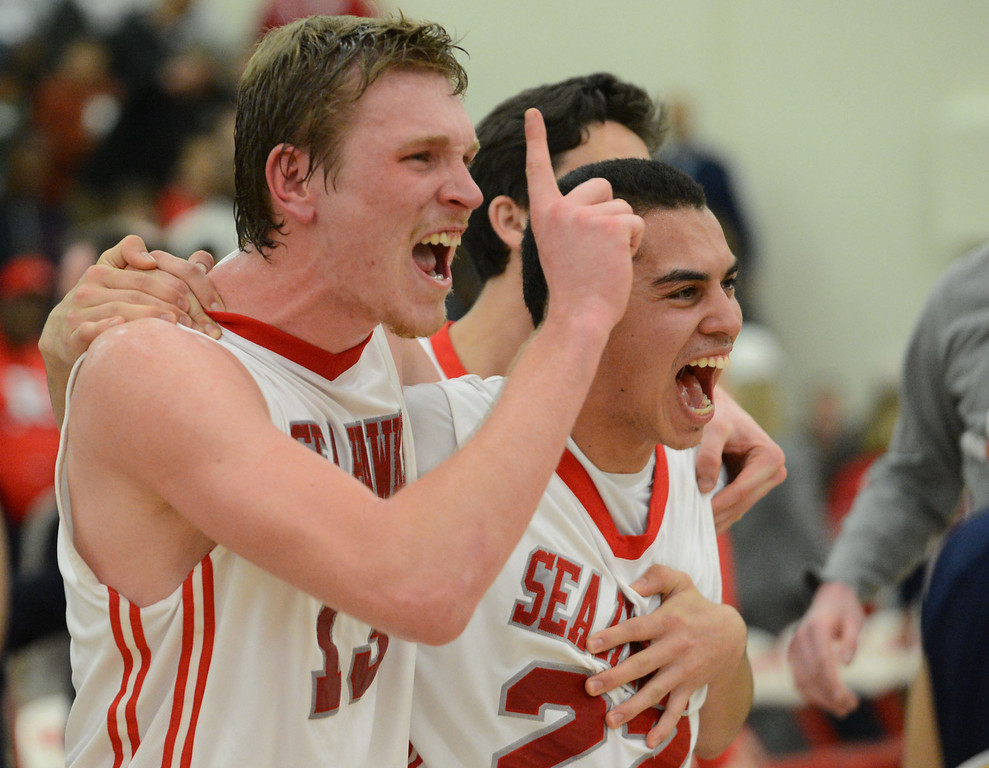 . Redondo Union\'s Sebastian Lindner (13) and Chris Henderson (22)  celebrate after winning 55-41 against Arroyo Grande in a CIF Southern Section Division II-A semifinal boys basketball game Tuesday night in Redondo Beach. 20130226 Photo by Steve McCrank / Staff Photographer
