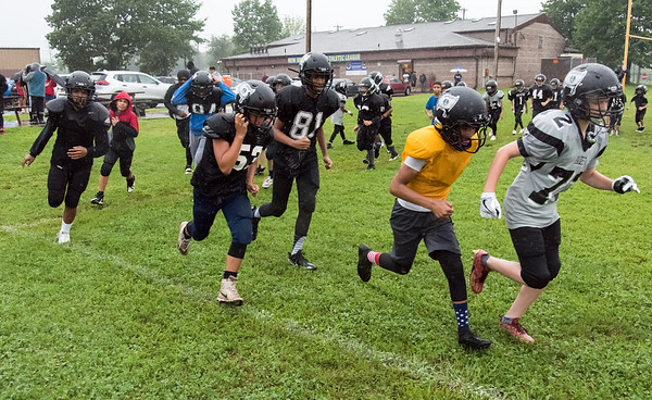 08/13/18 Wesley Bunnell   Staff New Britain PAL Raider teammates run laps during a heavy rain on Monday afternoon during team practice.