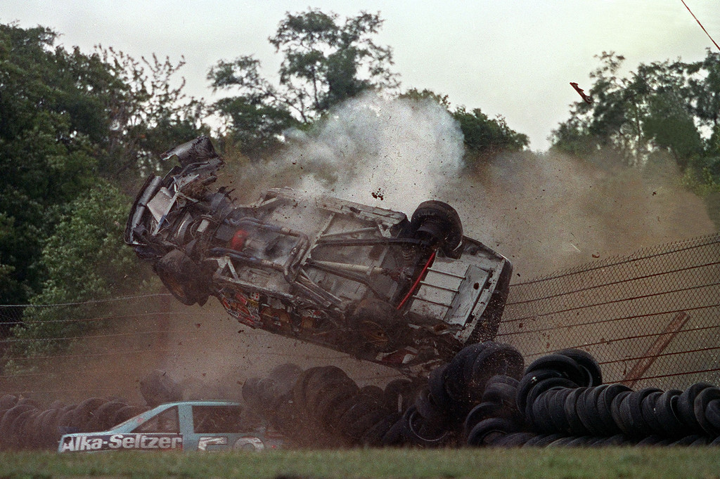 . The Pontiac of J.D. McDuffie flips over and crashes on top of Jimmy Means car, bottom, during the sixth lap of the Budweiser at the Glen NASCAR race in Watkins Glen, N.Y.  Driver McDuffie, a NASCAR veteran, died in this accident in Turn No. 5 on August 11, 1991. (AP Photo/Mike Okoniewski)