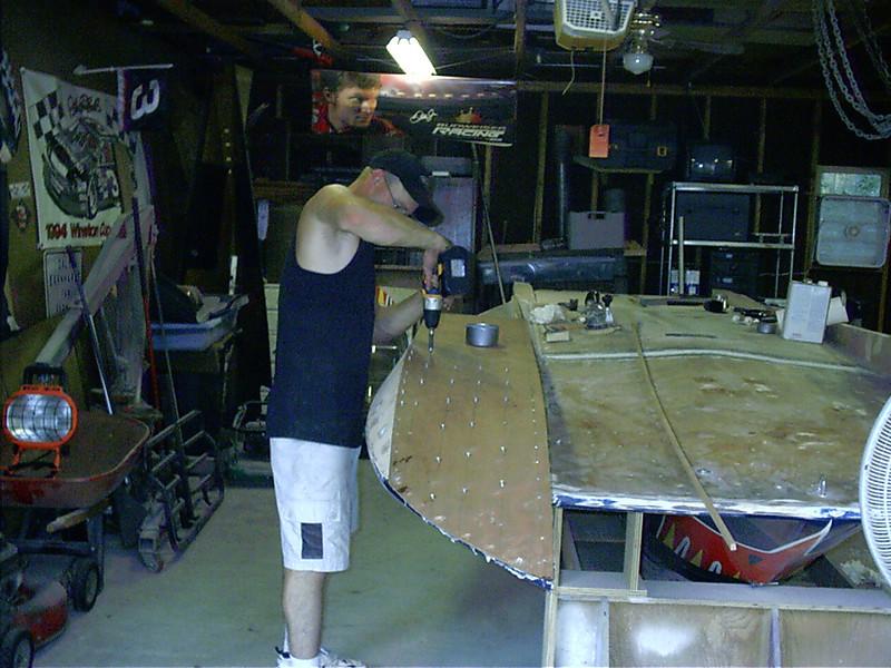 Screwing down new port sponson bottom.