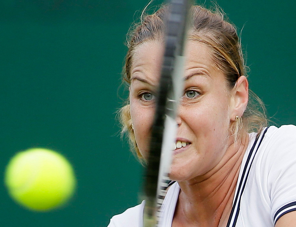 . Dominika Cibulkova of Slovakia plays a shot to Maria Elena Camerin of Italy during their Women\'s first round singles match at the All England Lawn Tennis Championships in Wimbledon, London, Tuesday, June 25, 2013.  (AP Photo/Alastair Grant)