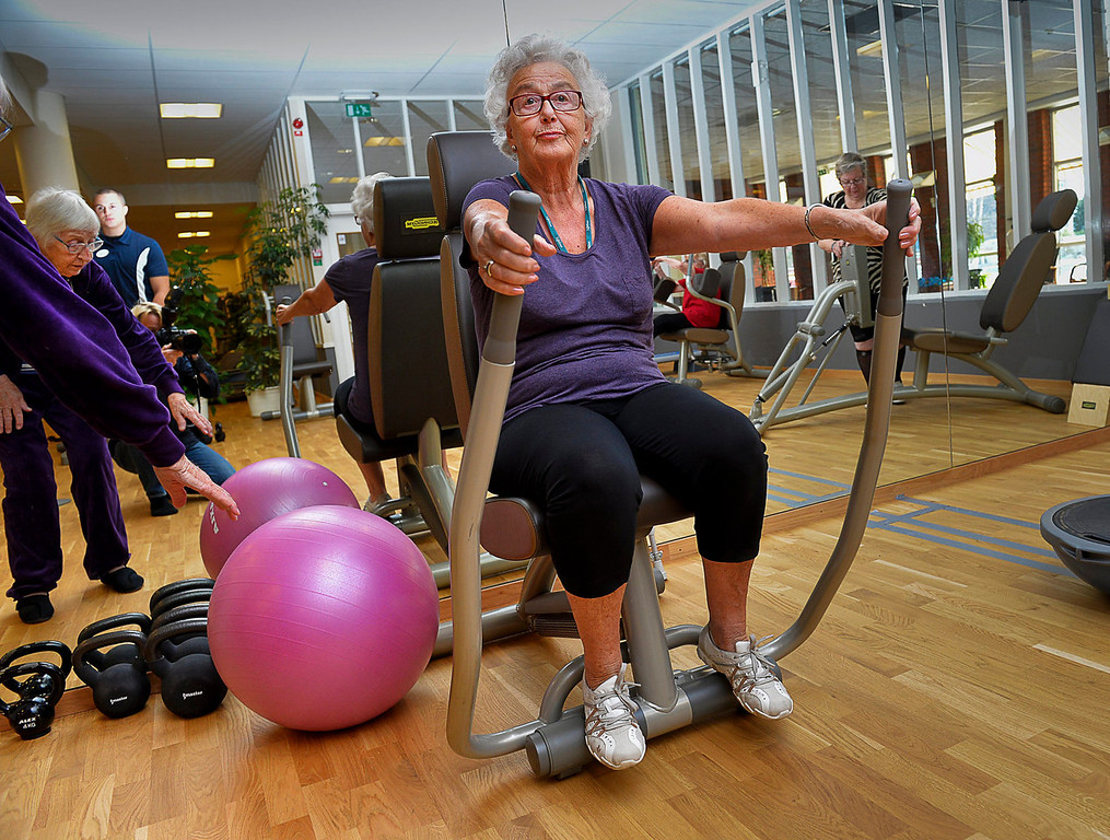 . Eighty-year-old Marianne Blomberg works out at a gym in Stockholm on Sept. 26, 2013 photo. Much of the world is not prepared to support the ballooning population of elderly people, including many of the fastest-aging countries, according to a global study scheduled to be released Tuesday, Oct. 1, by the United Nations and an elder rights group. The Swedish government has suggested people continue working beyond 65, a prospect Blomberg cautiously welcomes but warns should not be a requirement. (AP Photo/TT News Agency, Jonas Ekstromer)