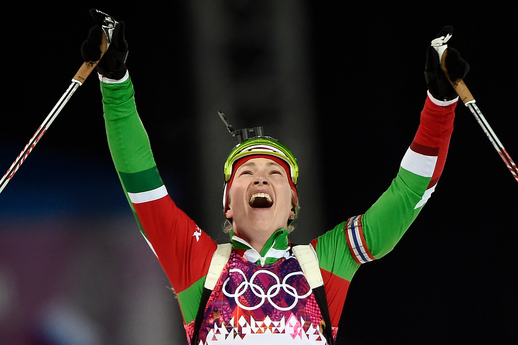 . Belarus\' Darya Domracheva celebrates as she wins gold in the Women\'s Biathlon 12,5 km Mass Start at the Laura Cross-Country Ski and Biathlon Center during the Sochi Winter Olympics on February 17, 2014, in Rosa Kuthor, near Sochi.   ODD ANDERSEN/AFP/Getty Images