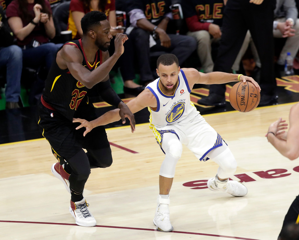 . Golden State Warriors\' Stephen Curry is defended by Cleveland Cavaliers\' Jeff Green during the first half of Game 3 of basketball\'s NBA Finals, Wednesday, June 6, 2018, in Cleveland. (AP Photo/Tony Dejak)