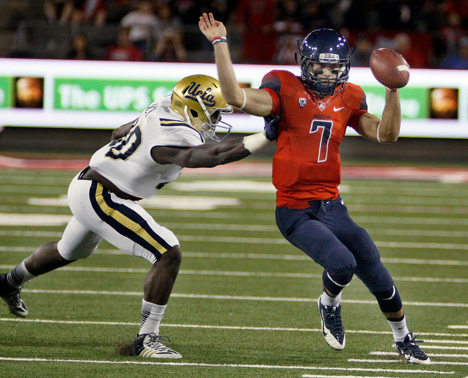 . Arizona quarterback B.J. Denker (7) is pushed out of bounds by UCLA\'s Myles Jack (30) in the first half of an NCAA college football game, Saturday, Nov. 9, 2013, in Tucson, Ariz.  (AP Photo/Wily Low)
