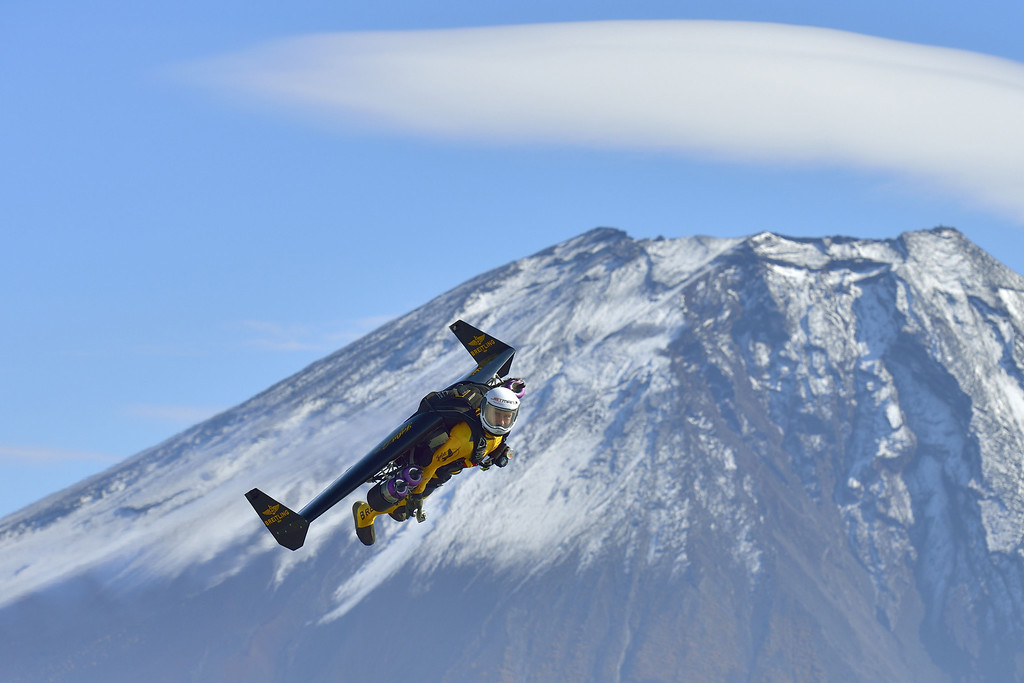 ". This handout picture taken near Fujinomiya in Shizuoka prefecture on November 1, 2013 and released on November 6, 2013 shows Swiss pilot Yves Rossy, or ""Jetman\"", flying near Mount Fuji.     AFP PHOTO / Breitling SA & JETMAN PROJECT / KATSUHIKO TOKUNAGA /AFP/Getty Images"