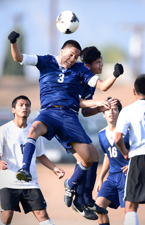 . Baldwin Park\'s Martin Torres (3) and Andy Castillo (8) go for a header as Baldwin Park defeats Northview 2-0 during Tuesday\'s game at Northview High School, February 11, 2014. (Photo by Sarah Reingewirtz/Pasadena Star-News)