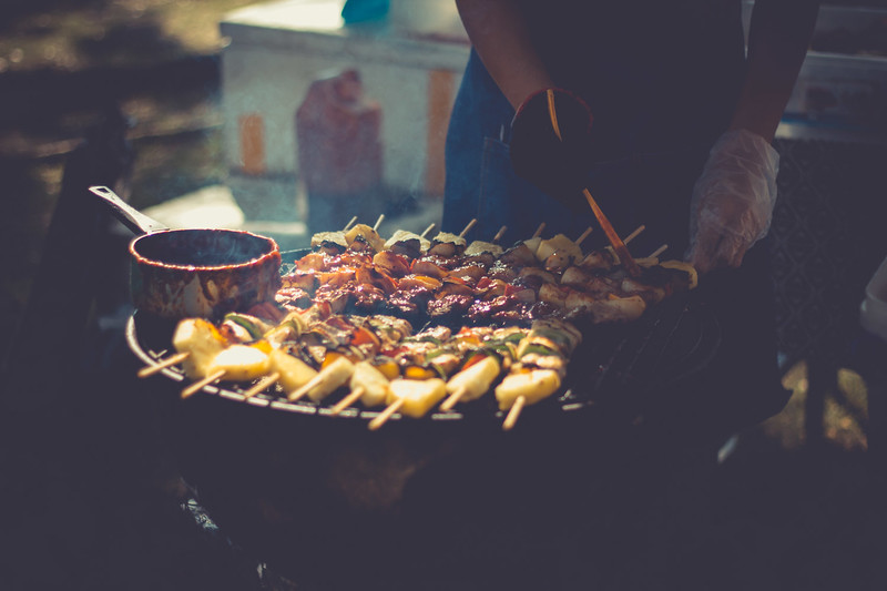 Preparation Of Barbecue, Grilled Skewers On Plate Outdoor. Grilled Shish Kebab On Metal Skewer. Chef