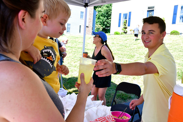 7/13/2019 Mike Orazzi | Staff Nico Fasold serves Jennifer Lucia and her son Andrew some lemonade during his Nicos Lemonade Stand on Northwest Drive in Plainville on Saturday.