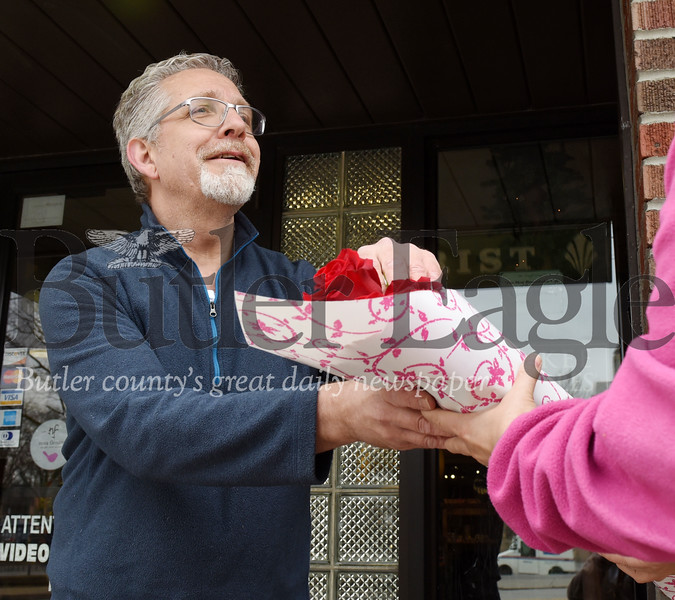 Harold Aughton/Butler Eagle: Ed Bloom, owner of Butler Florist, gave away 50 boxes of flowers,  dozens of red stemmed roses and other assortments of flowers Tuesday afternoon, March 24, 2020. According to Bloom he wanted to bring some joy to the community.