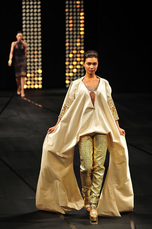. A model showcases designs by Albert Andrada on the runway at the finale show of the 2013 Philippine Fashion Week Holiday at the SMX convention center in Pasay City on May 26, 2013 in Manila, Philippines. (Photo by Veejay Villafranca/Getty Images)