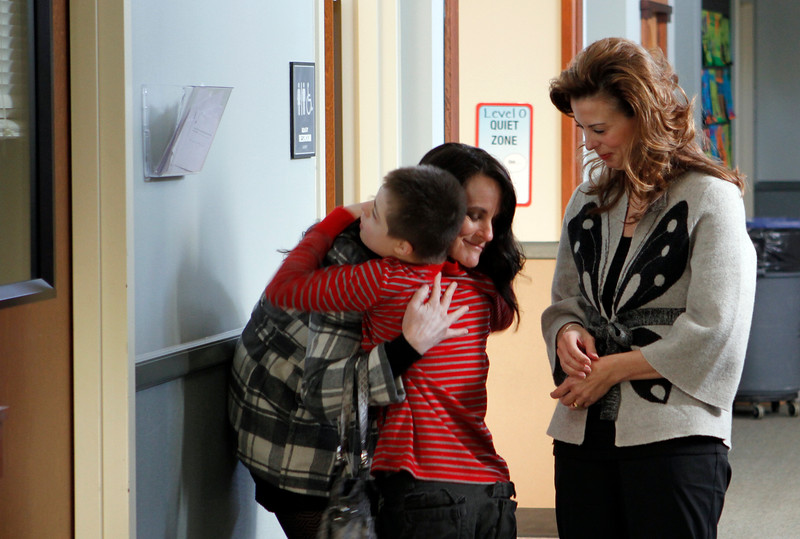 Noah hugs his mom as she drops him off to Hillyer at the CARE worship program at St Michael the Archangel. Photo by Susan McSpadden 011313