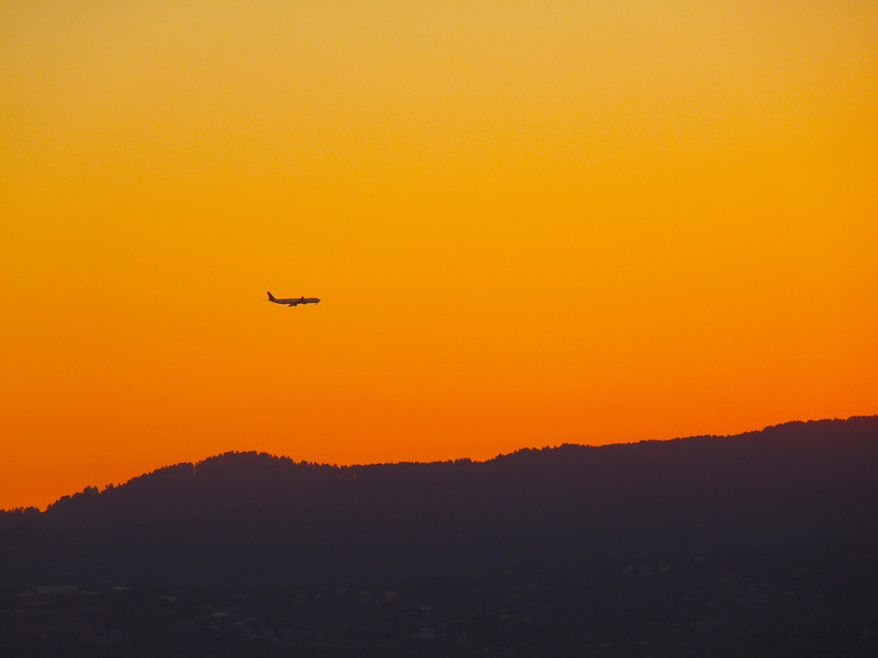 An afternoon flight over the mountains, in the golden sunset.
