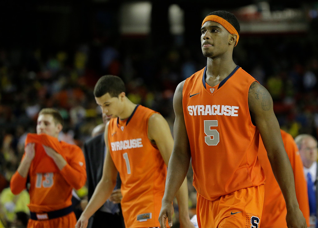 . Syracuse basketball players walk off the court after the second half of the NCAA Final Four tournament college basketball semifinal game against Michigan, Saturday, April 6, 2013, in Atlanta. Michigan won 61-56. (AP Photo/David J. Phillip)