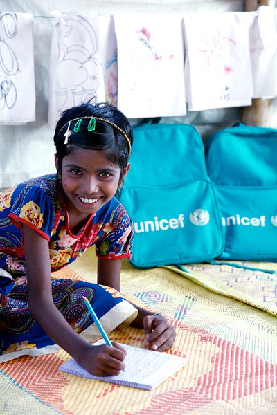 0168-0169Usmaera Akther, an 11-year-old Rohingya refugee child, poses for photograph inside the UNICEF-supported Seabird Learning Centre at the Balukhali makeshift settlement in Ukhia, Cox's Bazar, Bangladesh.     Photo: UNICEF / b.a.sujaN/Map