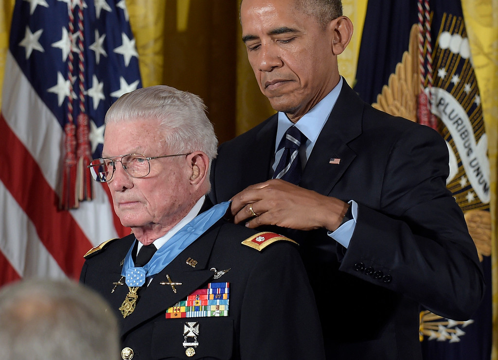 . President Barack Obama presents the Medal of Honor to retired Army Lt. Col. Charles Kettles of Michigan during a ceremony in the East Room of the White House in Washington, Monday, July 18, 2016. Kettles distinguished himself in combat operations near Duc Pho, Vietnam, and is credited with saving the lives of 40 soldiers and four of his own crew members. (AP Photo/Susan Walsh)