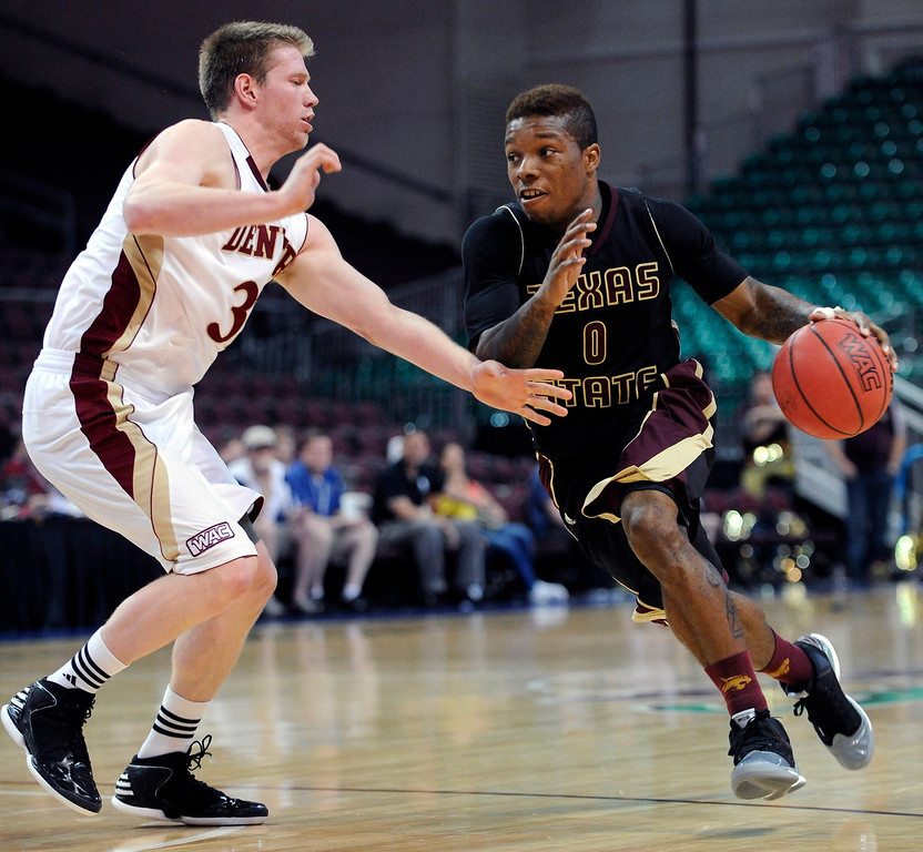 . Texas State\'s Phil Hawkins (0) drives the ball around Denver\'s Chase Hallam during the first half of a Western Athletic Conference tournament NCAA college basketball game on Thursday, March 14, 2013, in Las Vegas. (AP Photo/David Becker)