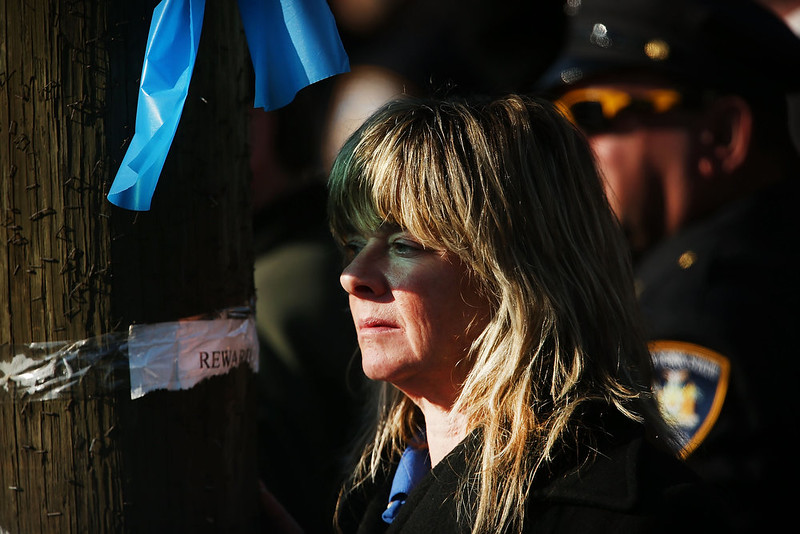 . A woman attends the funeral procession outside of the Christ Tabernacle Church during the funeral of slain New York City Police Officer Rafael Ramos, one of two officers murdered while sitting in their patrol car in an ambush in Brooklyn last Saturday afternoon on December 27, 2014 in New York City. Thousands of fellow officers, family, friends and Vice President Joseph Biden are expected at the church in the Glendale neighborhood of Queens for the funeral.  (Photo by Spencer Platt/Getty Images)