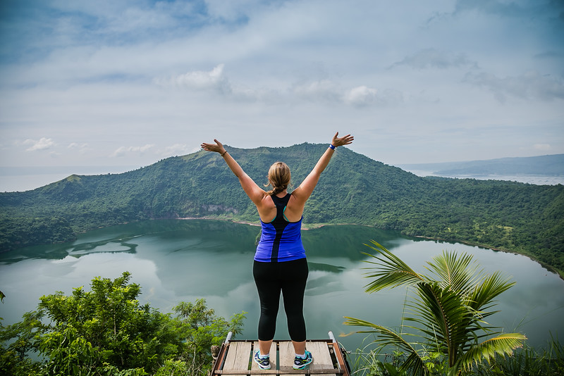 Lina Stock of Divergent Travelers Adventure Travel Blog at top of Taal Volcano