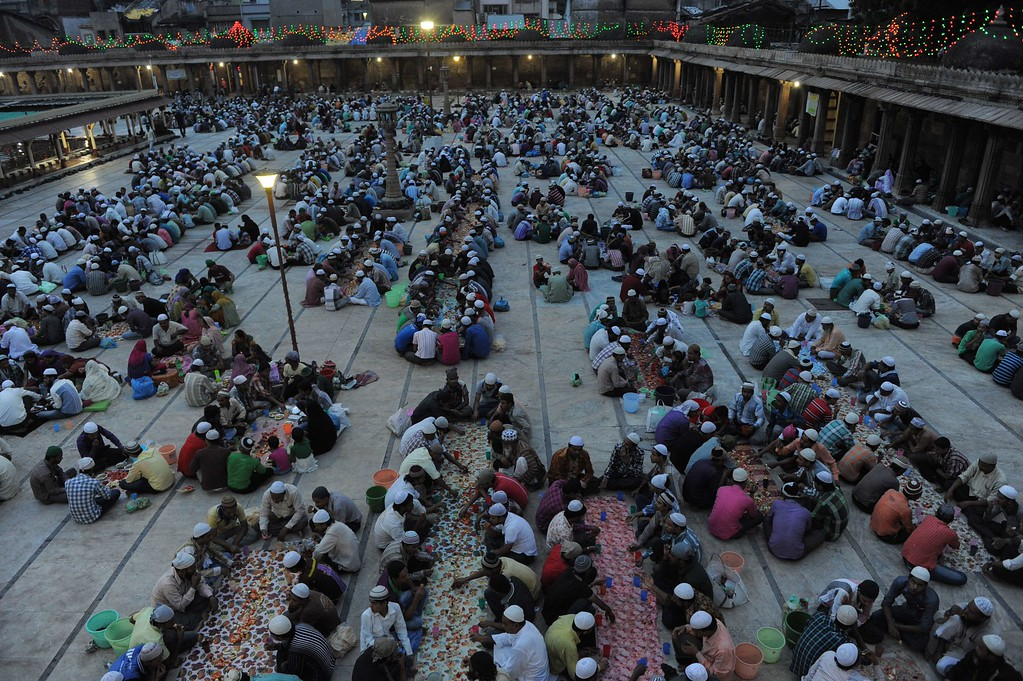 . Indian Muslims end their day\'s fast on the last day of Ramadan at The Shahi Jama Masjid in Ahmedabad on August 8, 2013.  Muslims across Asia celebrated the Eid al-Fitr festival with lavish feasts and religious services, even as bomb attacks killed at least 52 people in Pakistan and Afghanistan. Eid al-Fitr is set to be celebrated in India on August 9. SAM PANTHAKY/AFP/Getty Images